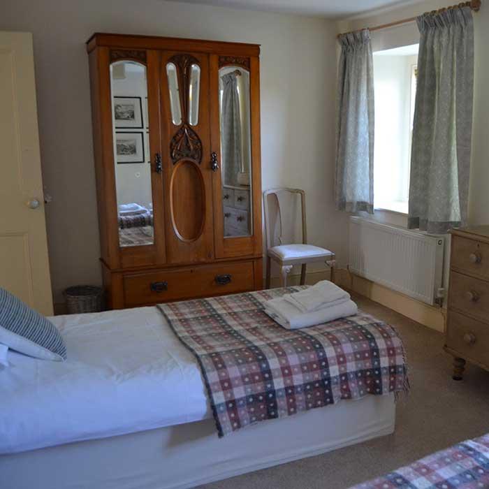 Bedroom in Manorbier cottage