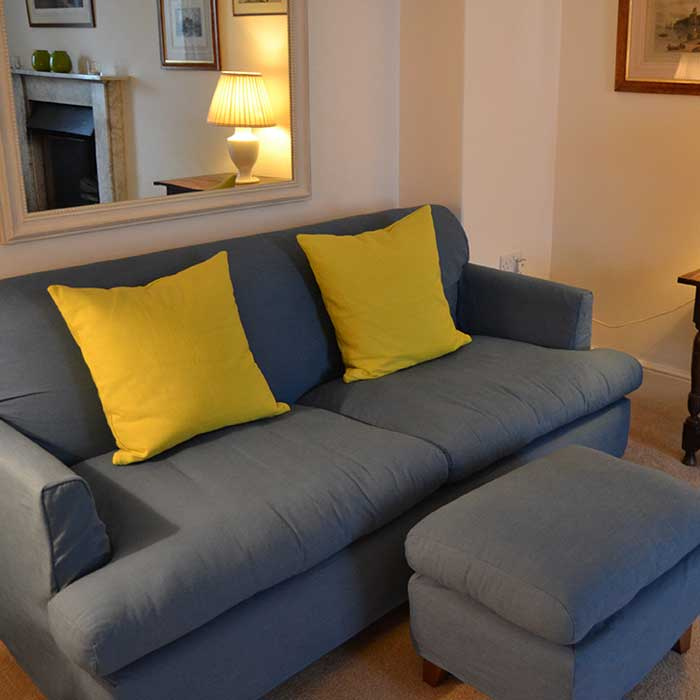 Comfy, cosy sitting room at Carew Cottage, Wales
